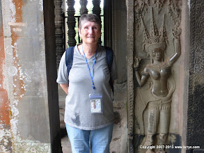 Photo: Irene and a carving of an earlier visitor.