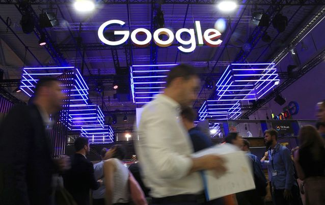 The Google logo hangs over the company's exhibition stand at the Dmexco digital marketing conference in Cologne, Germany. Picture: BLOOMBERG/KRISZTIAN BOCSI