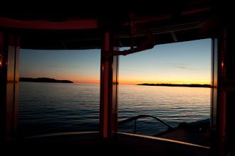 Photo: Sunset framed through the wheelhouse windows