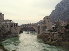 Photo: The Nererva River once separated the Muslim and Croat sides of Mostar.  The bridge was built in the 16th century.  The sultan told the architect he would be killed if it fell down.  He dug his own grave before it was opened, just in case.  It stood solidly for over 400 years!