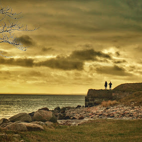 Us by Mane Manich - Landscapes Beaches ( two people trees sky clouds water sea stones rocks shore beach )