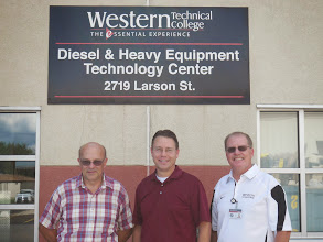Photo: Instructor Duane Yachwak and parts manager Greg Hutson give alumnus Keith Steenlage a tour of the new facility.