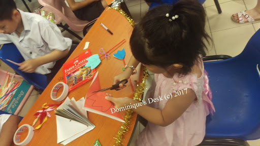 Tiger girl doing crafts at the school bazzar