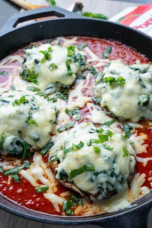 "Spinach and Ricotta Stuffed Portobello Mushrooms in Tomato Sauce""Mushrooms, cheese and tomatoes..."