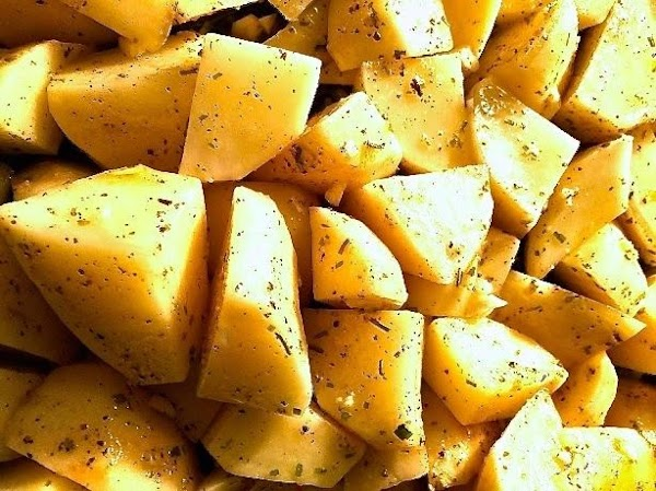 Remove casserole from oven, add the potatoes, garlic and spices, mixing well to evenly...