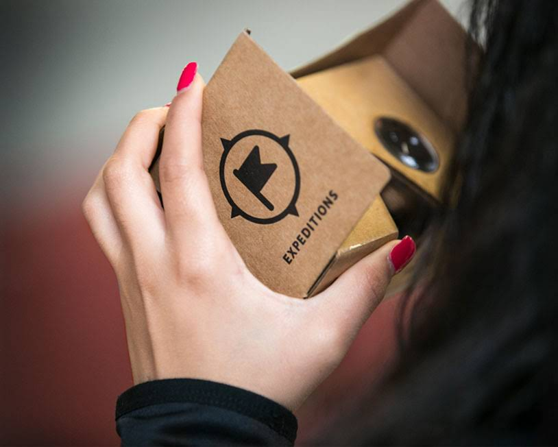 Close up of hands holding a Google Cardboard VR for Google Expeditions