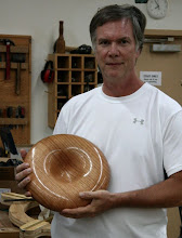 "Photo: Doug Pearson showing his red oak ""doughnut"" vessel"