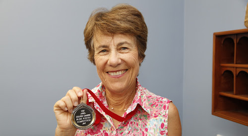 Narrabri poet Jacqui Warnock with her medal won in the national Golden Damper Bush Poetry Competition.