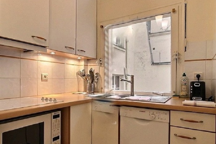 Full kitchen at 1 Bedroom Serviced Apartment in Louvre Street