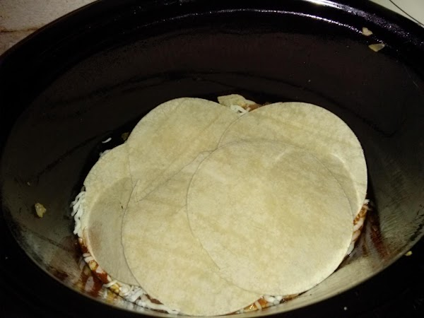 Place 1-2 ladles of sauce mix in bottom of large slow cooker. Place a...