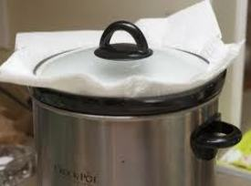 Fill a 6-7 qt. round or oval slow cooker with 1/2 inch of water...