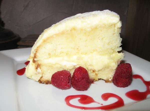 Lemoncello Creme Cake With Raspberry Chambord Syrup And Fresh Raspberries.