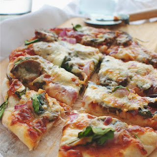 Pizza with Pesto Sausage, Spinach and Onion