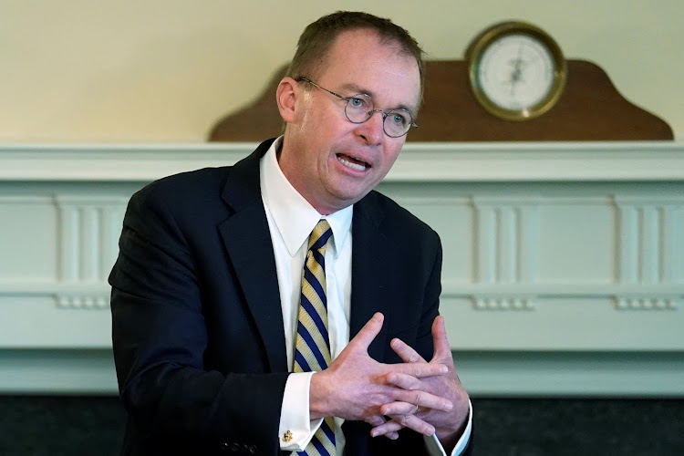 White House budget director Mick Mulvaney presents proposals to consolidate executive agencies at a cabinet meeting at the White House on June 21 2018. Picture: REUTERS