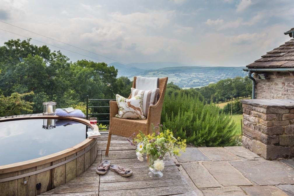 Recline in the hot tub and enjoy the panoramic views at The Wilds