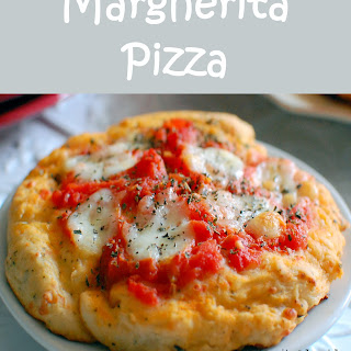 Margherita Pizza with Home-made Parmesan Basil Crust.