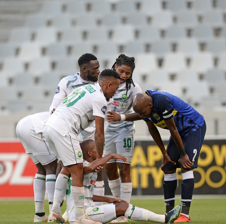 AmaZulu players gather around Luvuyo Memela of AmaZulu after he wins his team a penalty during the DStv Premiership match between Cape Town City FC and AmaZulu FC at Cape Town Stadium on April 29, 2021 in Cape Town.