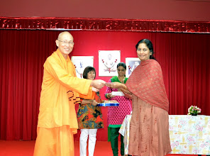 Photo: Visweswaran Manasa's mother receiving the Award from Swamiji on her behalf. Manas has done well in O level.