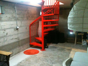 "Photo: This is the spiral stair that comes off the master bedroom down to the basement. The basement is officially ""unfinished"" (without AC into it), so its 249 sq feet are not included in the square footage of the house (which is 2072 square feet). It would function great as a kids play room, storage area, music making zone, party space... It is very cool in the summer.  The 2072 also does NOT include the front porch 160, deck 350, and garage 280. The lot size 10,400 sq ft and does not have the CC&Rs/covenant restrictions of the rest of the neighborhood, since it is the original farm. You can have livestock if you want!"