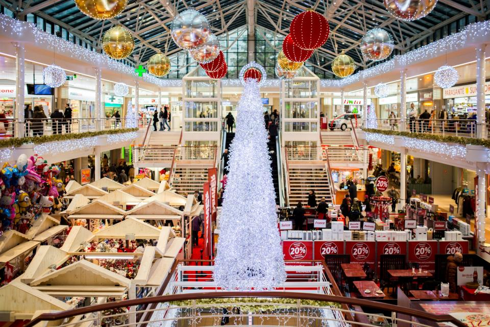 shopping mall christmas christmas tree lights ball decorations ornaments bazaar people