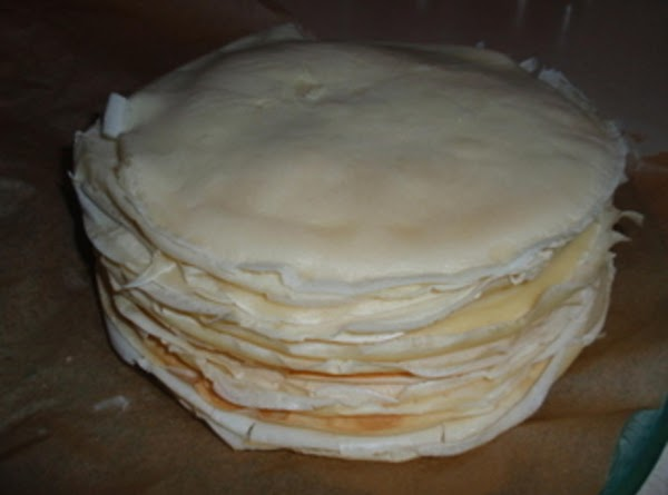 As they come out of the pan add a new layer of parchment paper...
