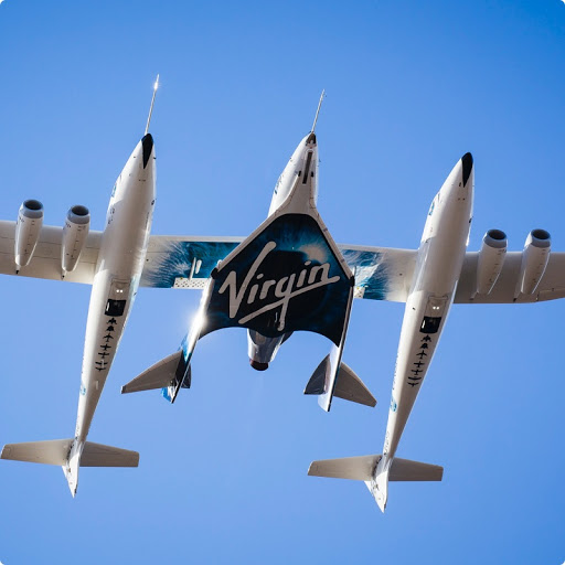 Photo of a Virgin Galactic jet in a hangar.