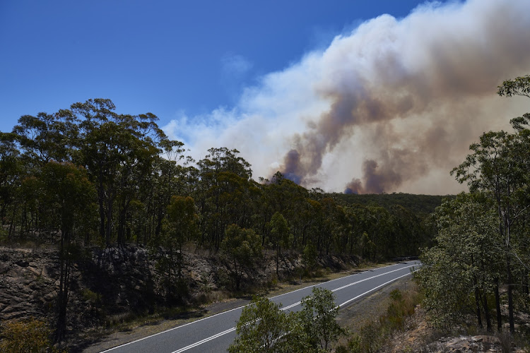 A general view of smoke as flames from the Gospers Mountain bushfire reach the areas surrounding Colo Heights on November 13 2019 in Sydney, Australia. Picture: GETTY IMAGES/ BRETT HEMMINGS