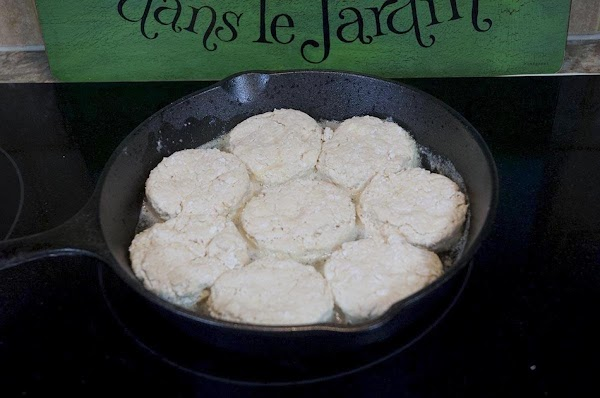 Remove the skillet from the stovetop, and add the biscuits.