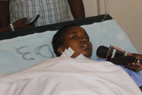 Naomi Chepkemboi a third year student at Pwani university recuperating at the Kilifi County Referral hospital after being stabbed  ex boyfriend