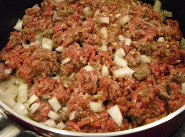 Preheat oven to 350 degrees.  In a medium-sized skillet on medium-high heat, cook...