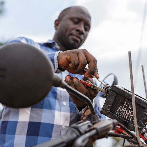 The team installing a sensor on a motorbike known as a boda boda