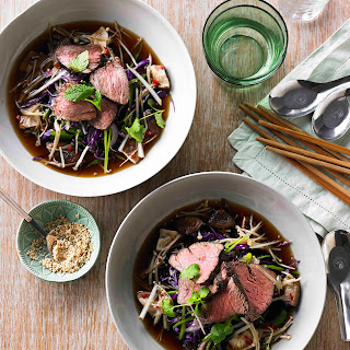Spiced beef rump medallions with Asian slaw and black broth.