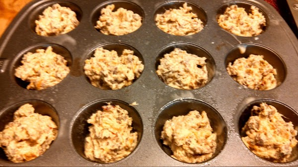If not using muffin liners, liberally spray muffin tins. Using a tablespoon (or a...