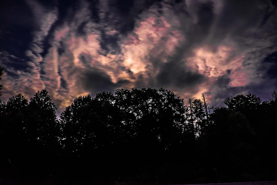 Lightmare by Anthony Mara - Landscapes Cloud Formations ( lights, clouds, silhouette, dark, trees, forest, night, long exposure, shadows )