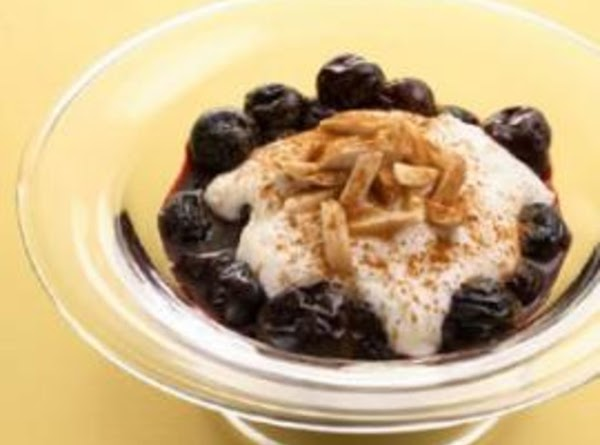 To serve, in each of 4 dessert or parfait glasses layer frozen yogurt and...