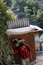 Photo: Sherpa carrying supplies up the mountain