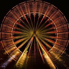 Christmas Ferris Wheel by Marco Bertamé - City,  Street & Park  Night ( lights, ferris, market, wheel, amusement, christmas, round, night, long exposure, circle, motion, turning,  )