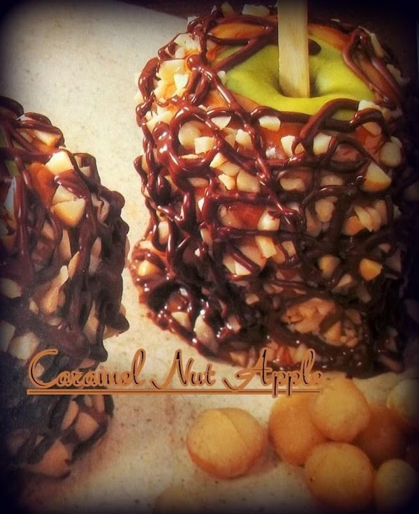 Dip apples as soon as caramel is ready. Scrape the excess caramel from the...