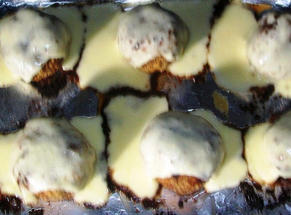 Once the meatballs are done, top the meatballs with the mozzarella cheese, turn the...