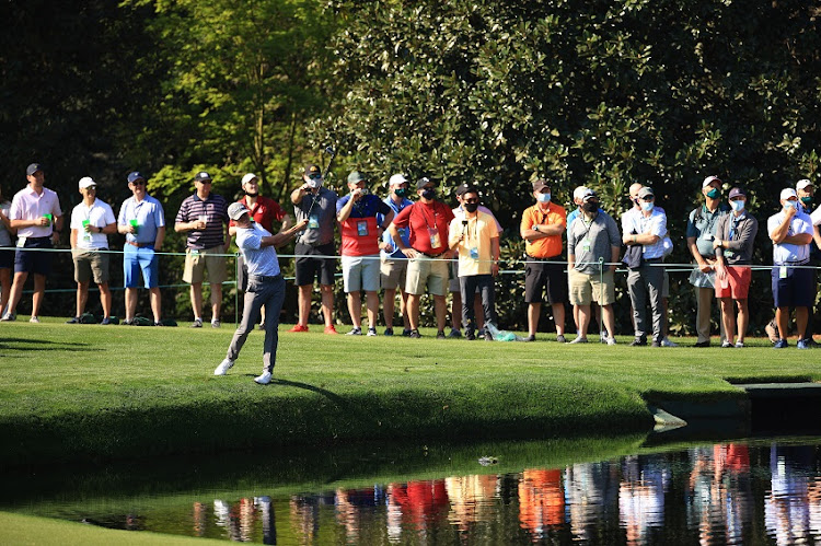 Justin Thomas of the United States skips a ball across the pond on the 16th hole during a practice round prior to the Masters at Augusta National Golf Club on April 06, 2021 in Augusta, Georgia.