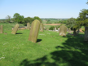 Photo: Gravestones in the yard of the church at Swanton Morley.