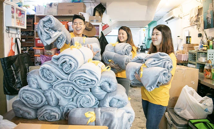 Staff from Hush Home gather blankets for donation