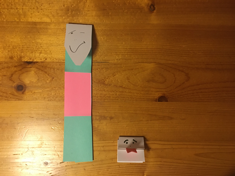Tall creature and short creature made from strips of paper