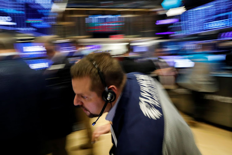 Traders work on the floor of the New York Stock Exchange in New York, the US. Picture: REUTERS/BRENDAN McDERMID