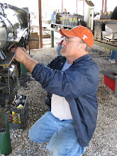Photo: Rick Pike working on his lubricator, which broke while running so well.  HALS 2009-0228