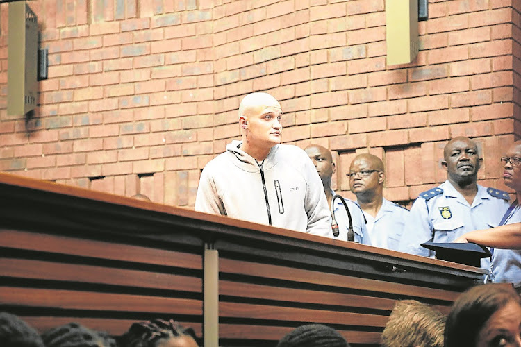 Nicholas Ninow, who is accused of raping a seven-year-old child in the bathroom of Dros restaurant in Pretoria, appears before a packed Pretoria magistrate's court.
