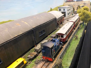 Photo: 010 Hunslet 0-6-0T No.1 Sussex brings a passenger service past the workshop and carriage shed area .
