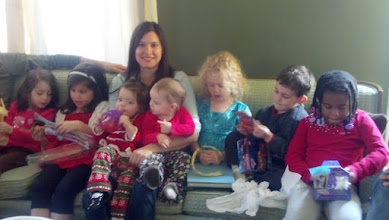 Photo: Jenny w/ her children! Unfortunately, I was taking the pic against the light