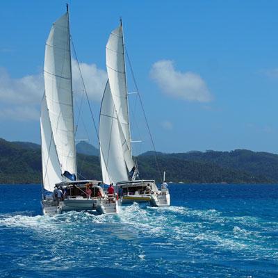 2 catamarans racing in tahiti