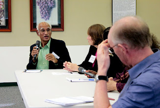 Photo: Muni Muniappan answers a question while participating on the environmental stressors panel.